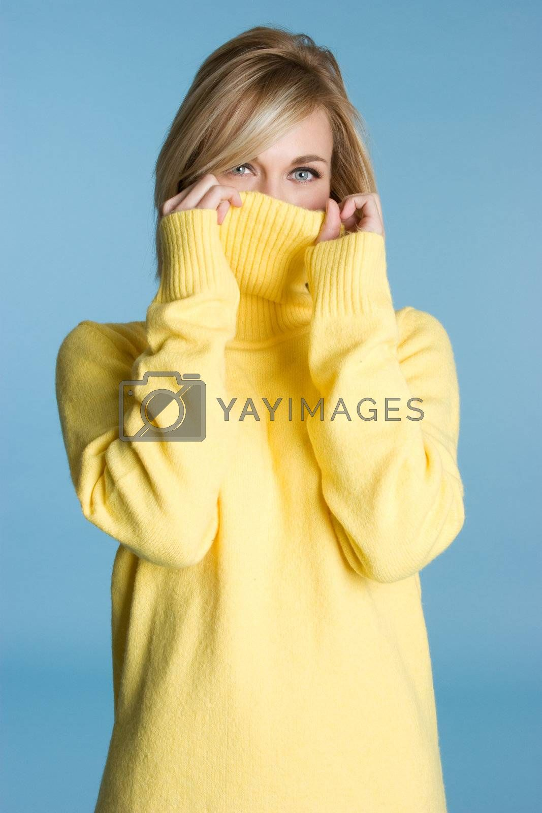 Pretty girl wearing yellow sweater