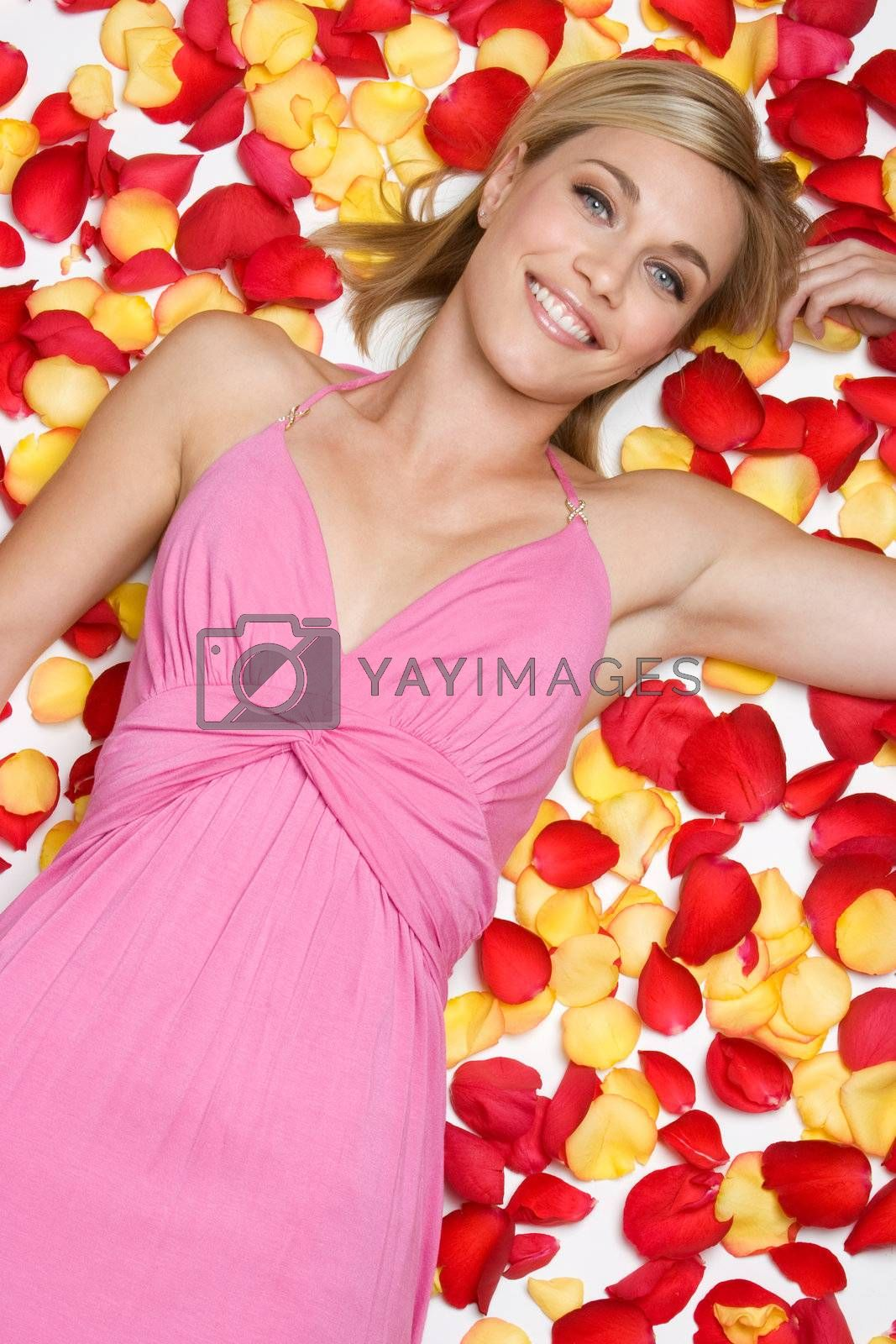 Blond woman laying in petals