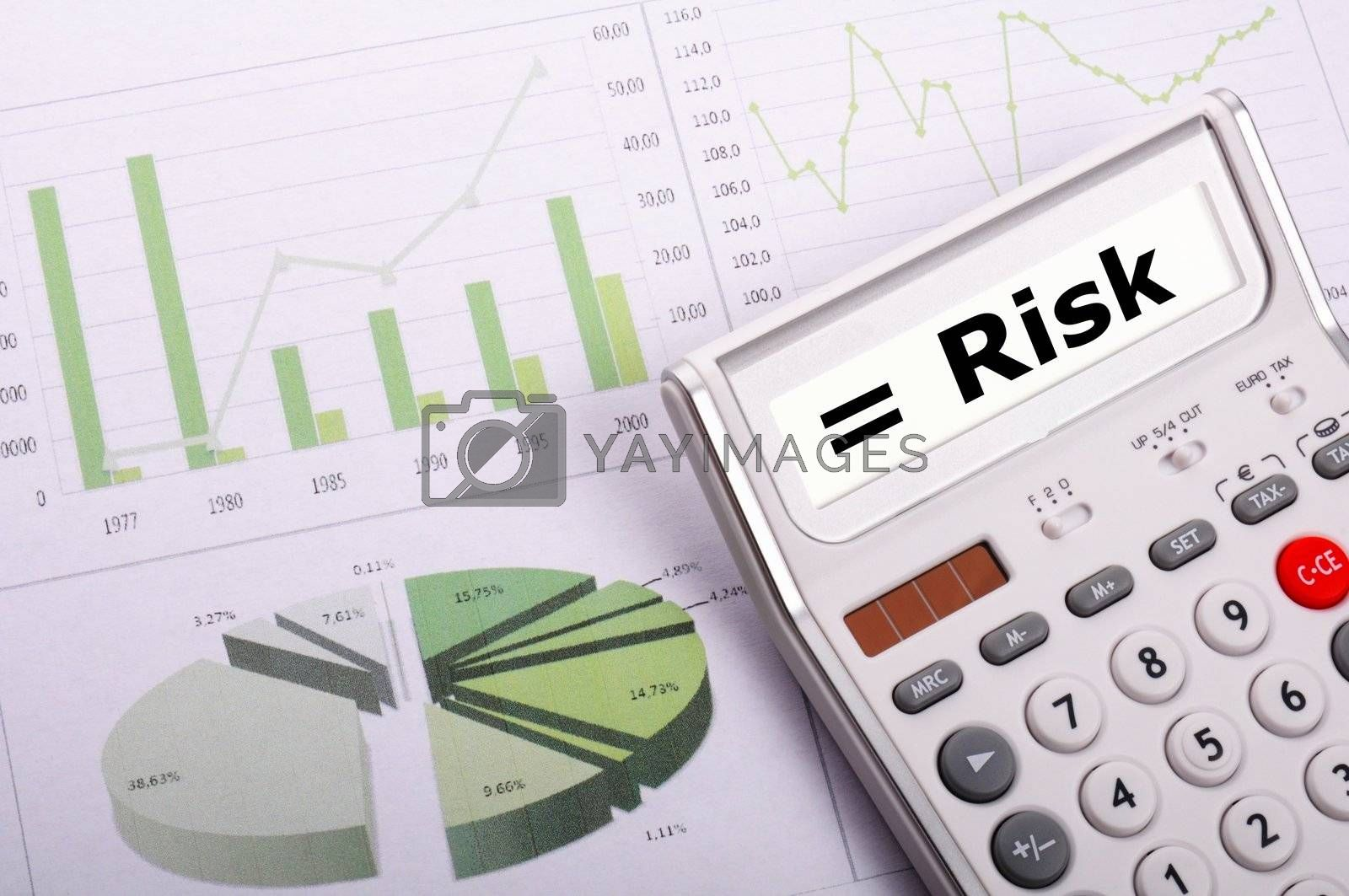 risk management concept with calculator showing financial success