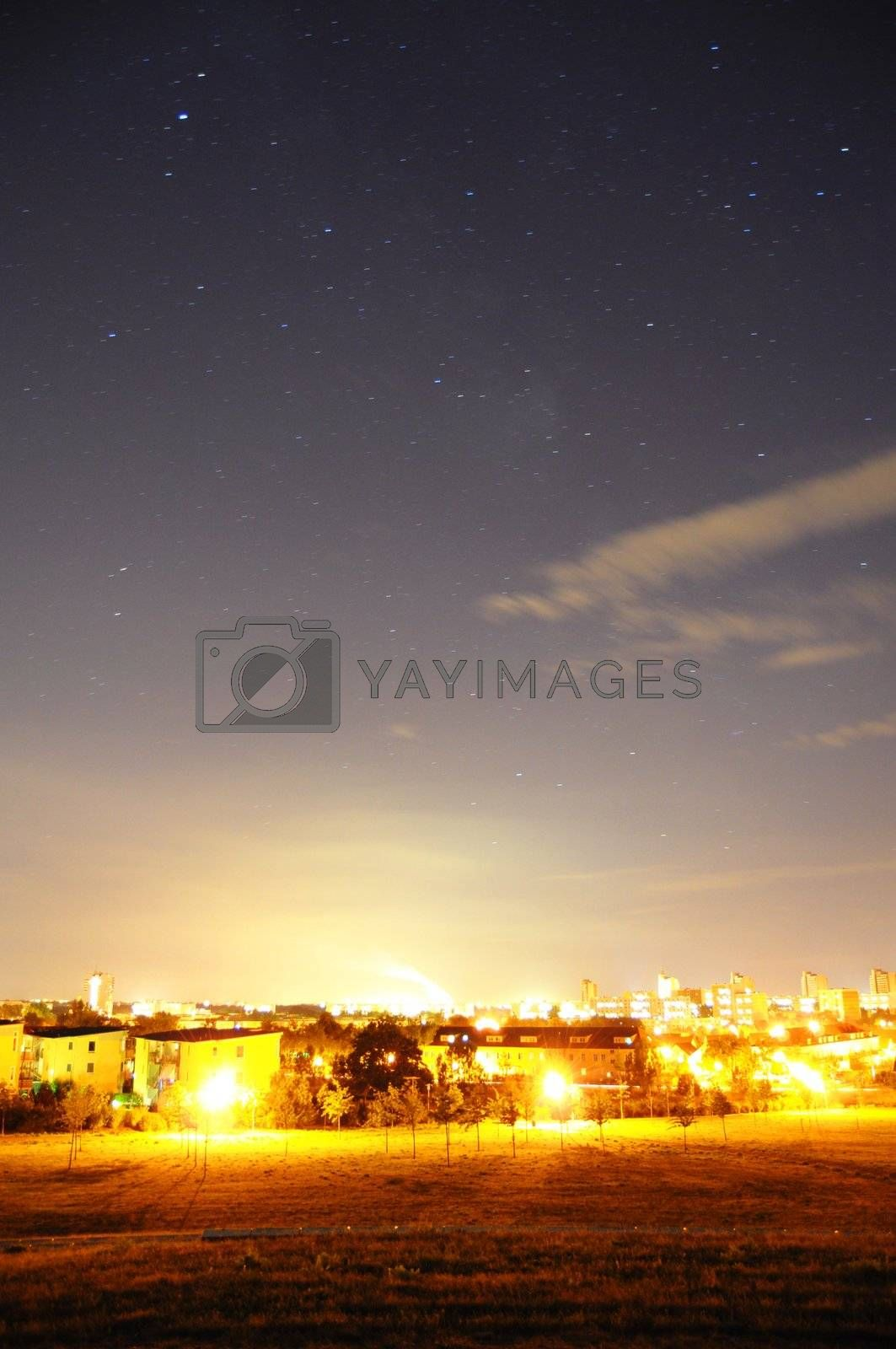night sky with stars over the town or city and copyspace