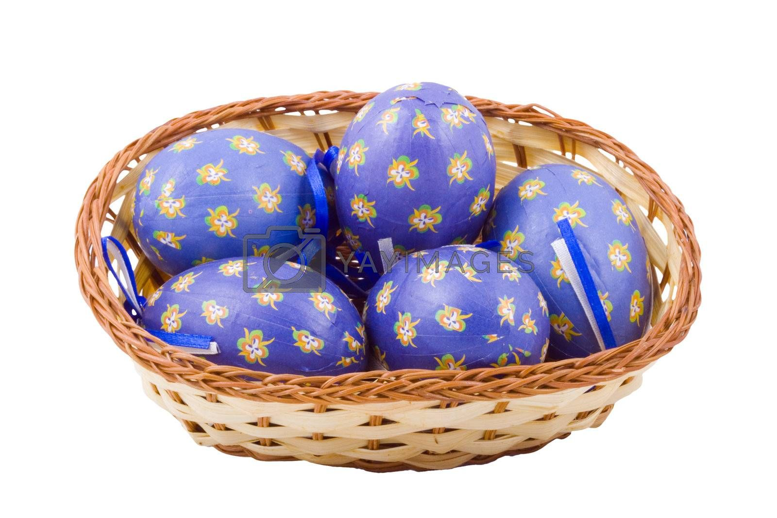 a basket of blue easter eggs isolated on the white background