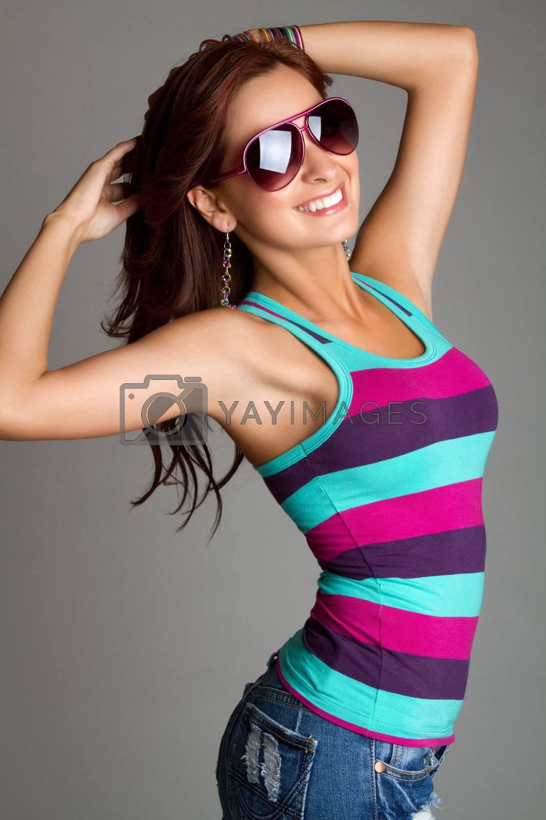 Beautiful smiling woman wearing sunglasses