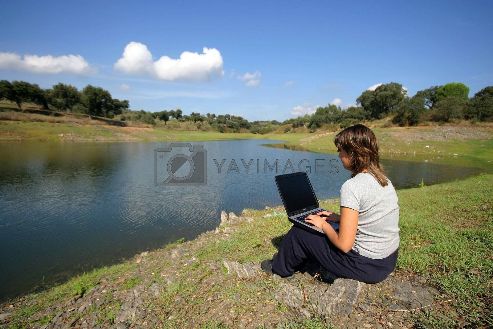 girl working in laptop in the nature