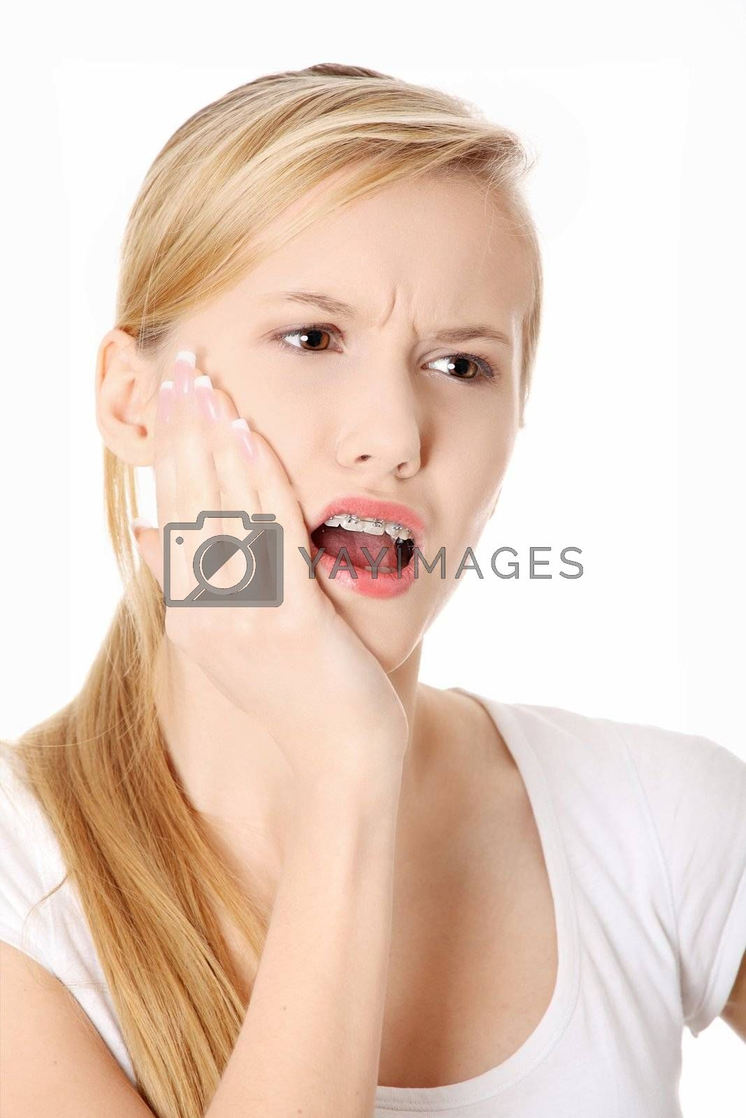 Beautiful young woman is having toothache isolated on white