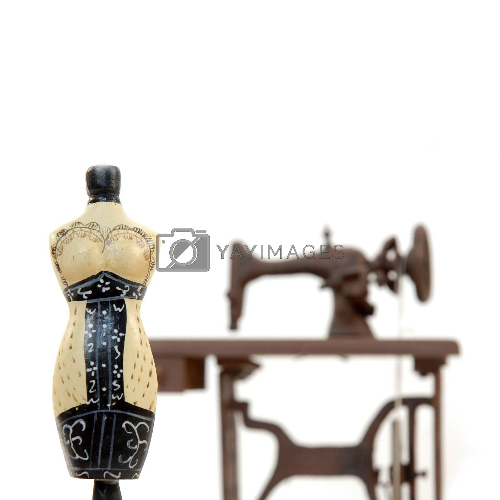 female mannequin and sewing machine isolated on white background