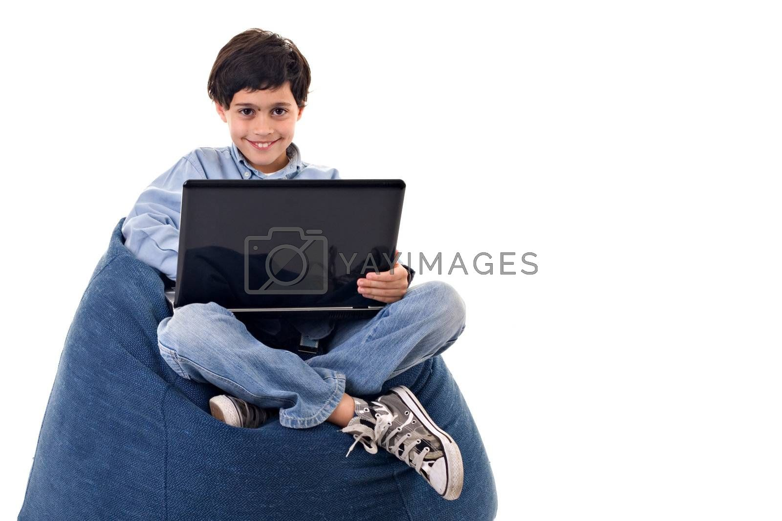 Cute kid sitting using a laptop over white background