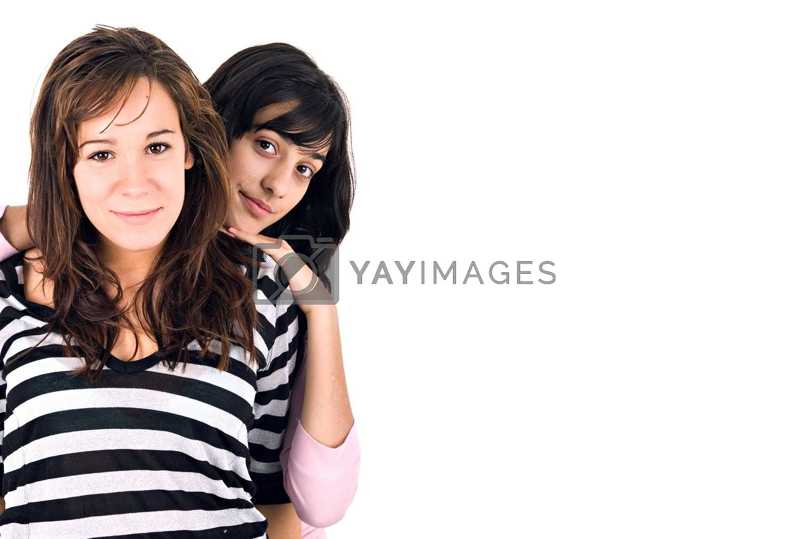 Two girls portrait with copy space, over white background.