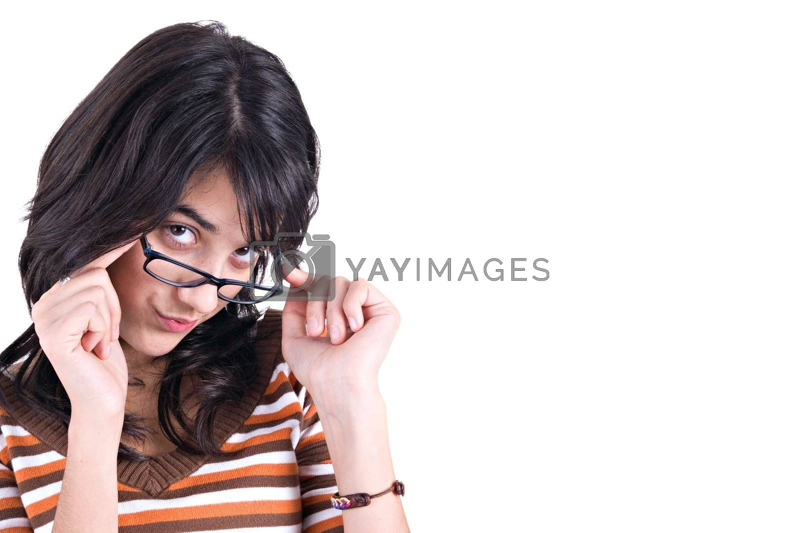 Girl wearing glasses with cute silly expression.with copy space. White background.