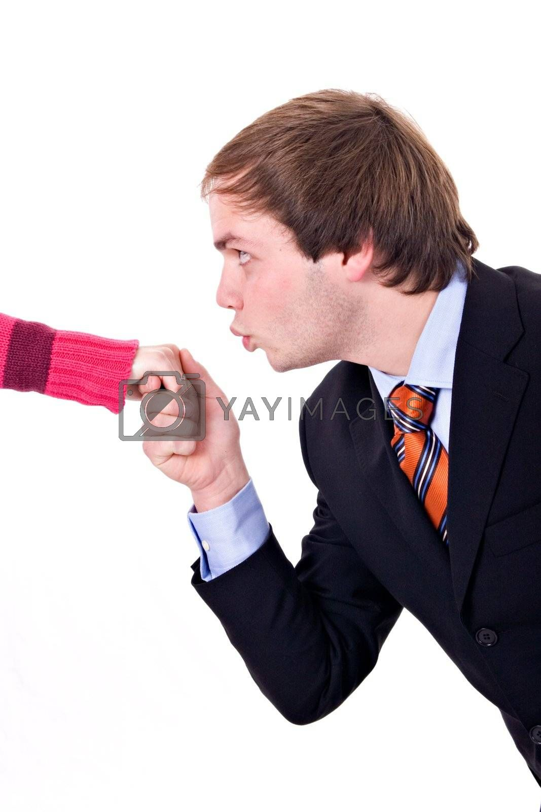 Young man with suit and tie, kissing a lady's hand.