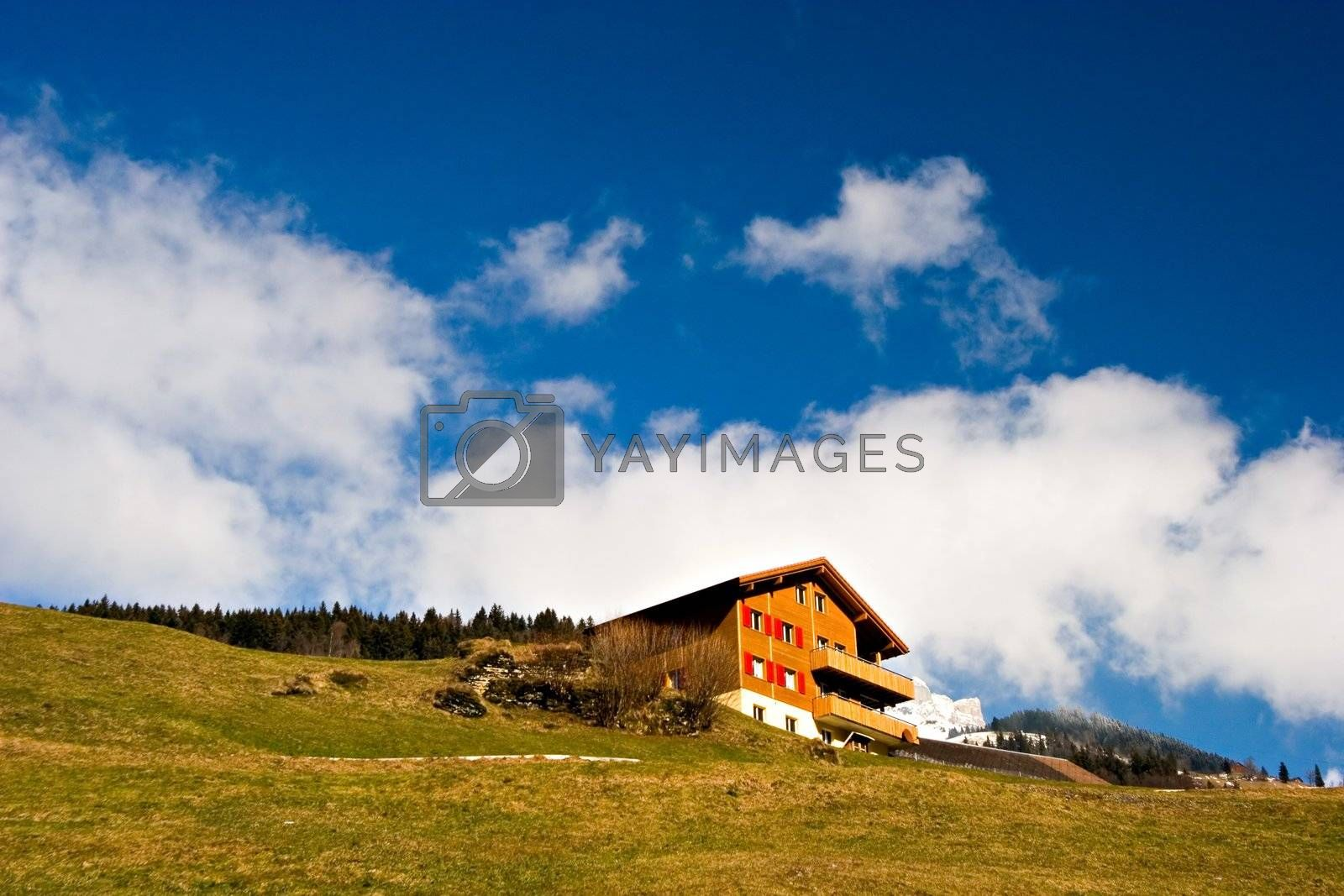 Typical rural house in Switzerland on a sunny day.