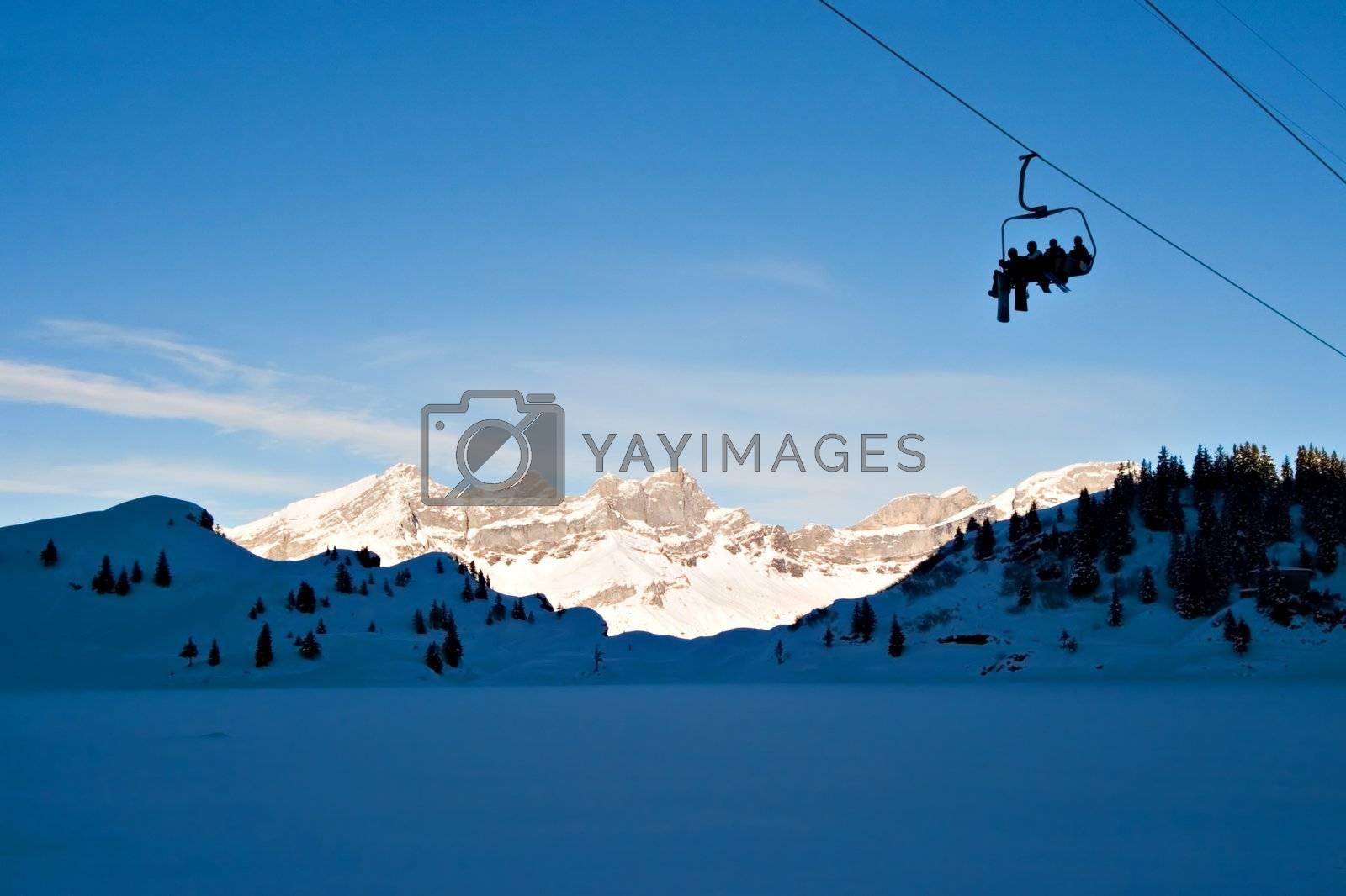 Skiers on Ski Lift, on the Swiss Alps.