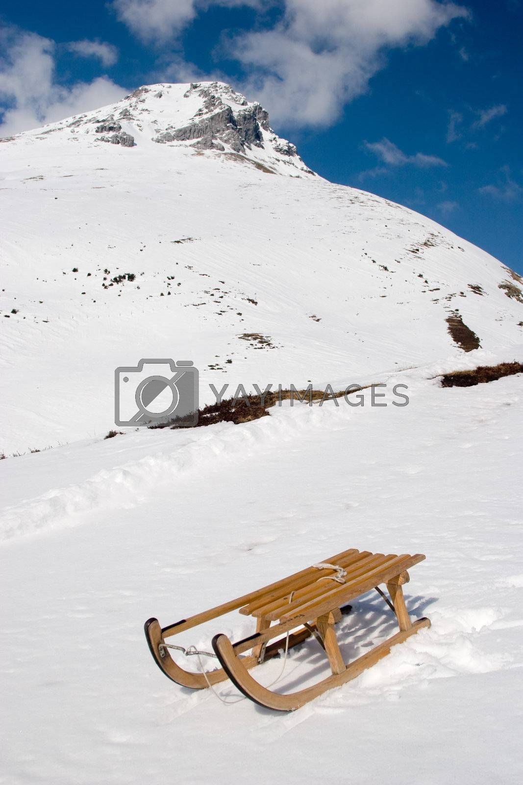 Photo of a sled on a mountain in the Swiss Alps.