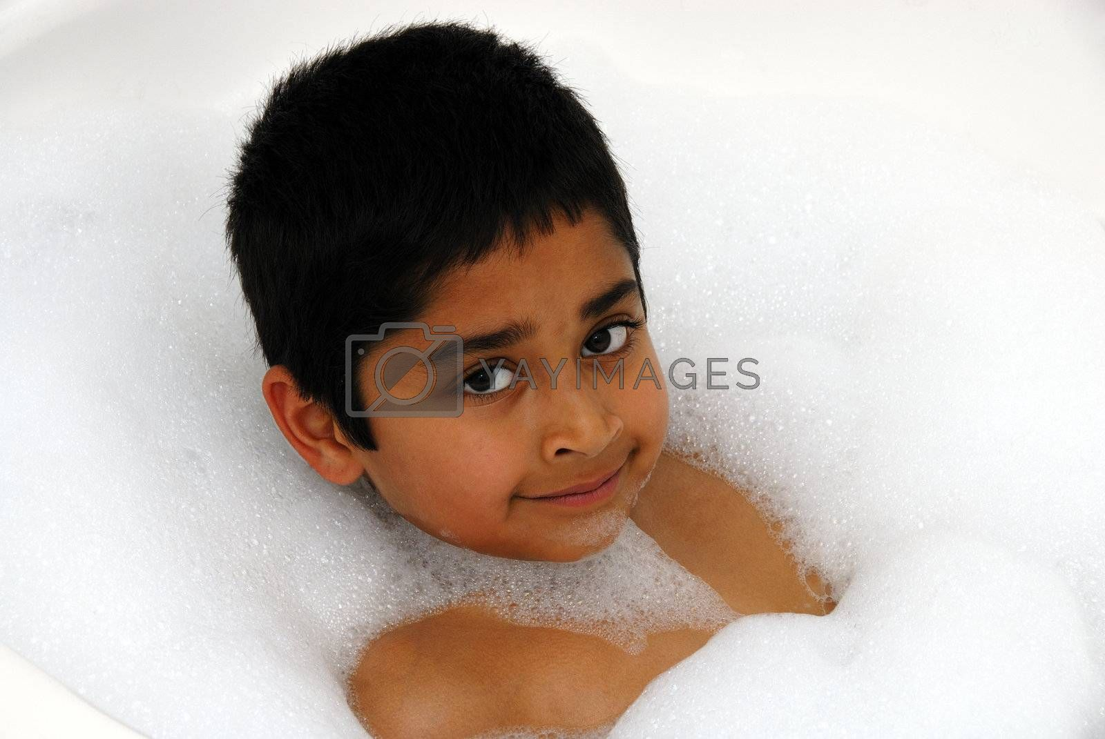 A happy kid enjoying his bubble batch
