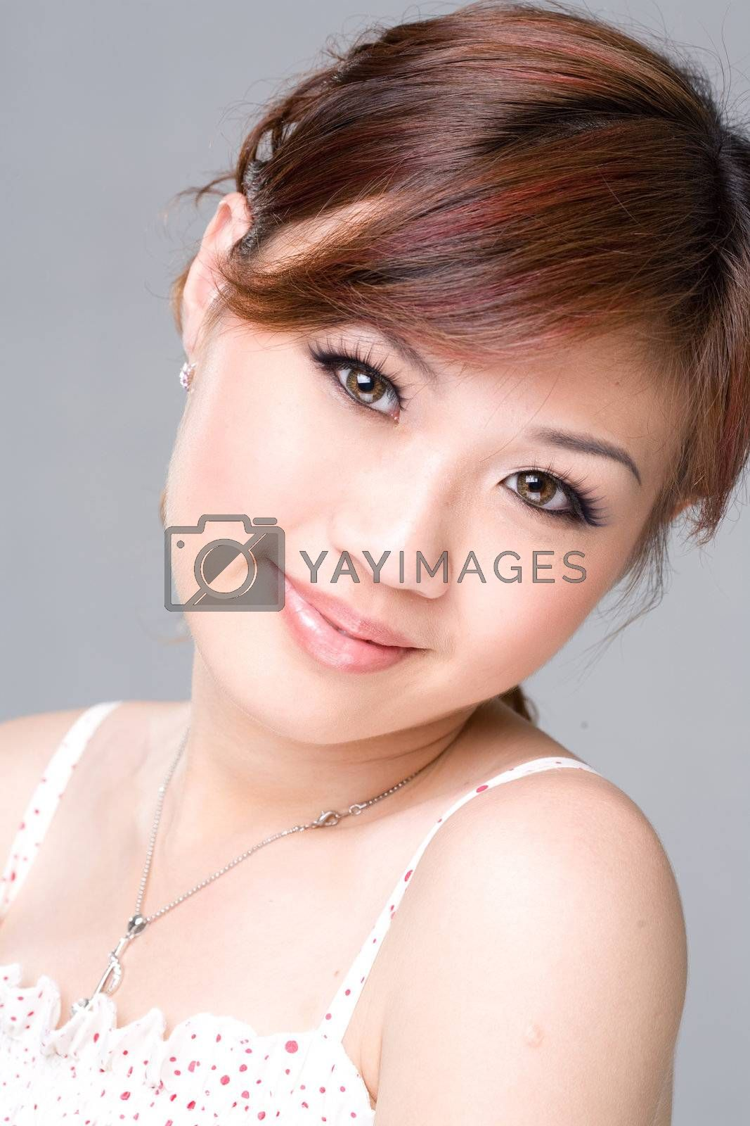 youthful sweet smile of an asian girl
