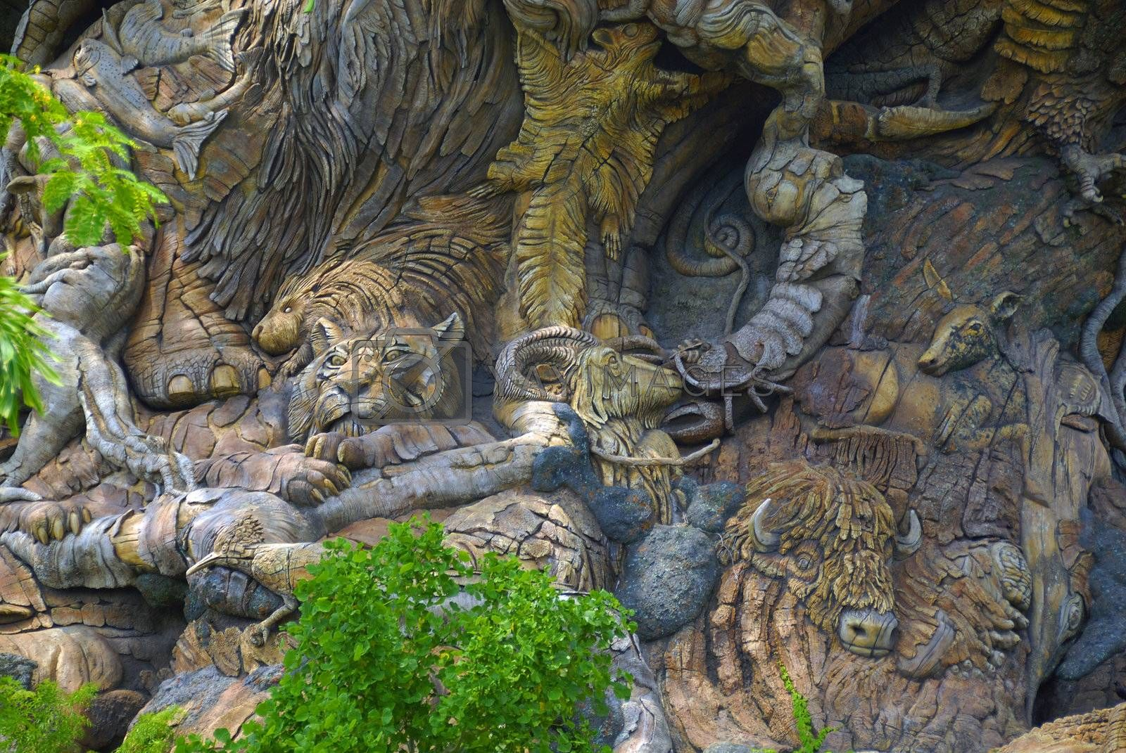 Various animals carved on the trunk of a tree