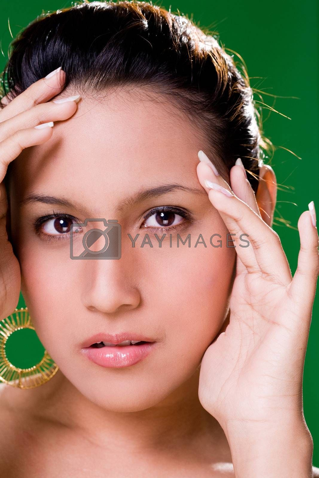 facial close up of a beautiful eurasian woman smile with cup hands