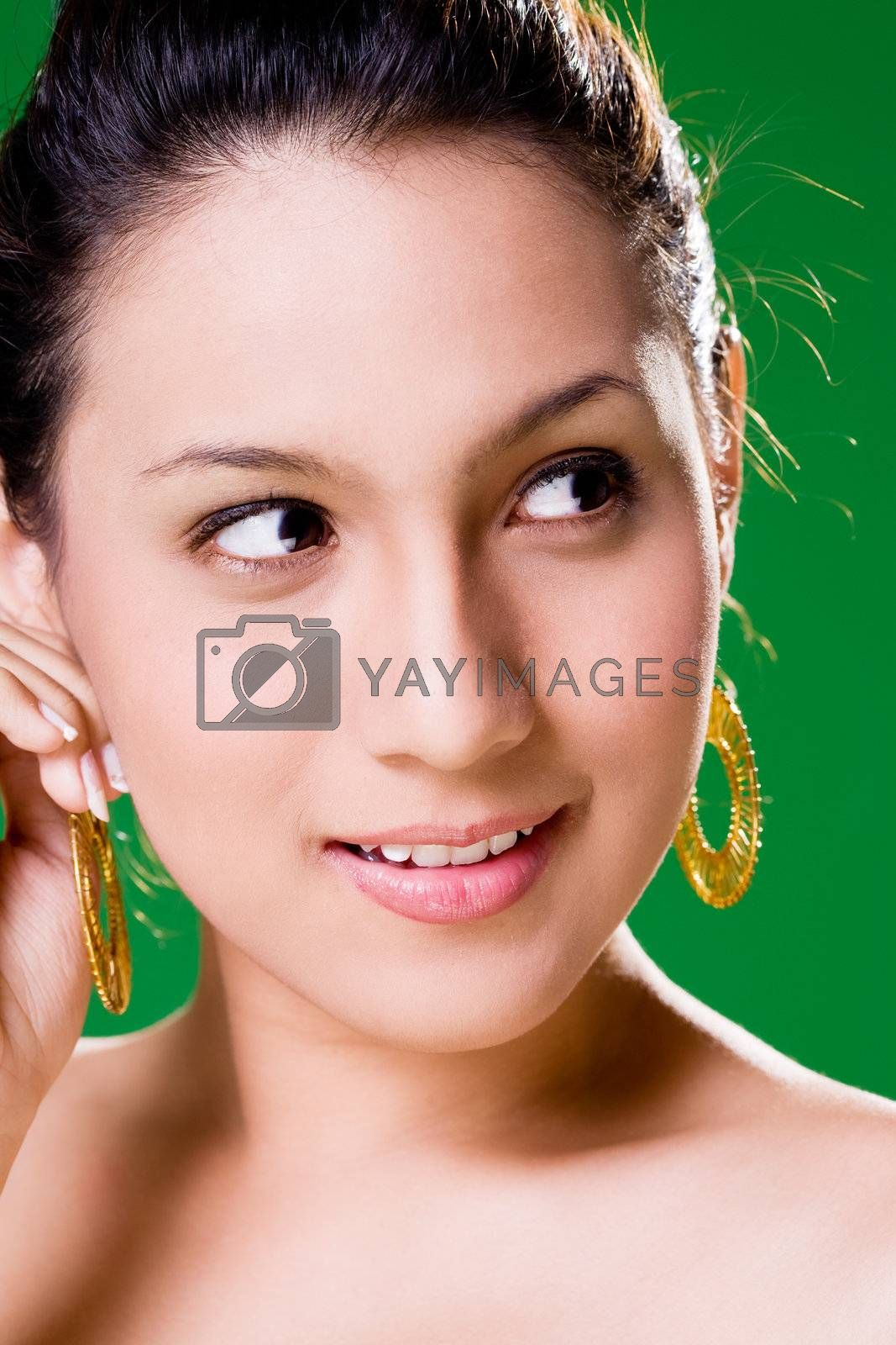 facial close up of a beautiful eurasian woman with a happy smile