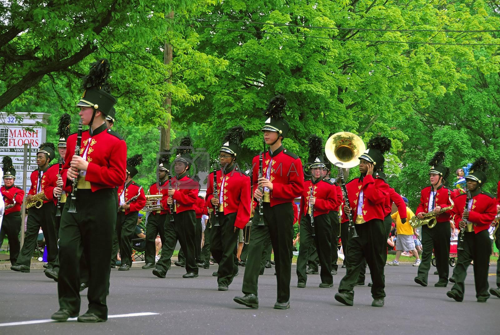 A grounp of band men playing at a local parade
