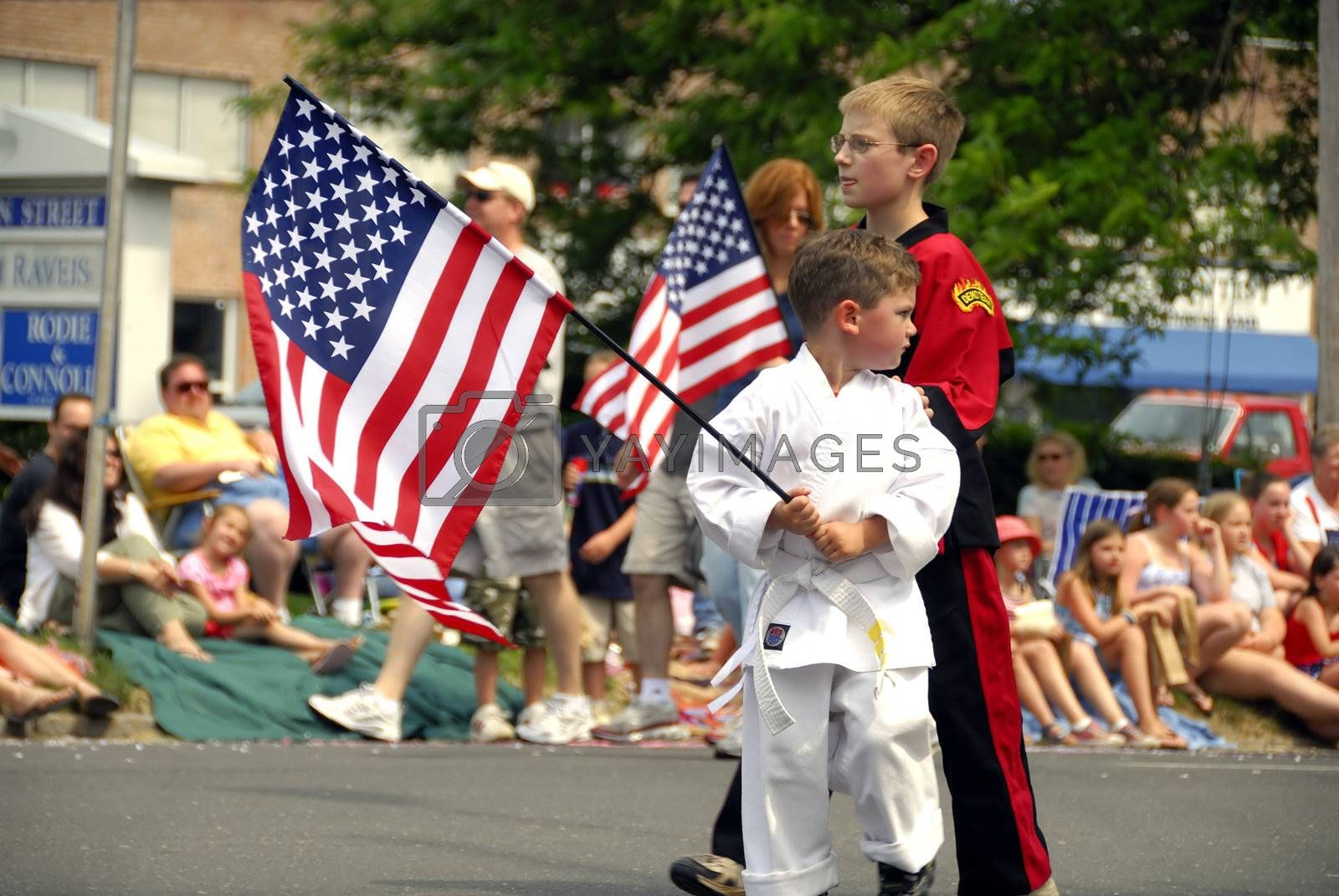 A group of kids walking in the memorial day parade