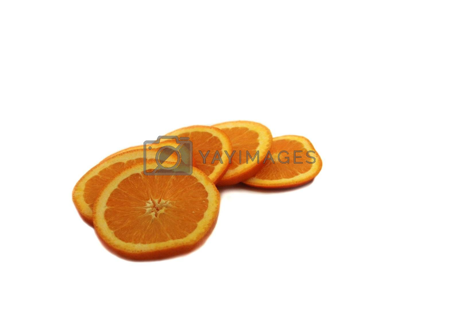 Orange slices ready for eating. arranged on white background.