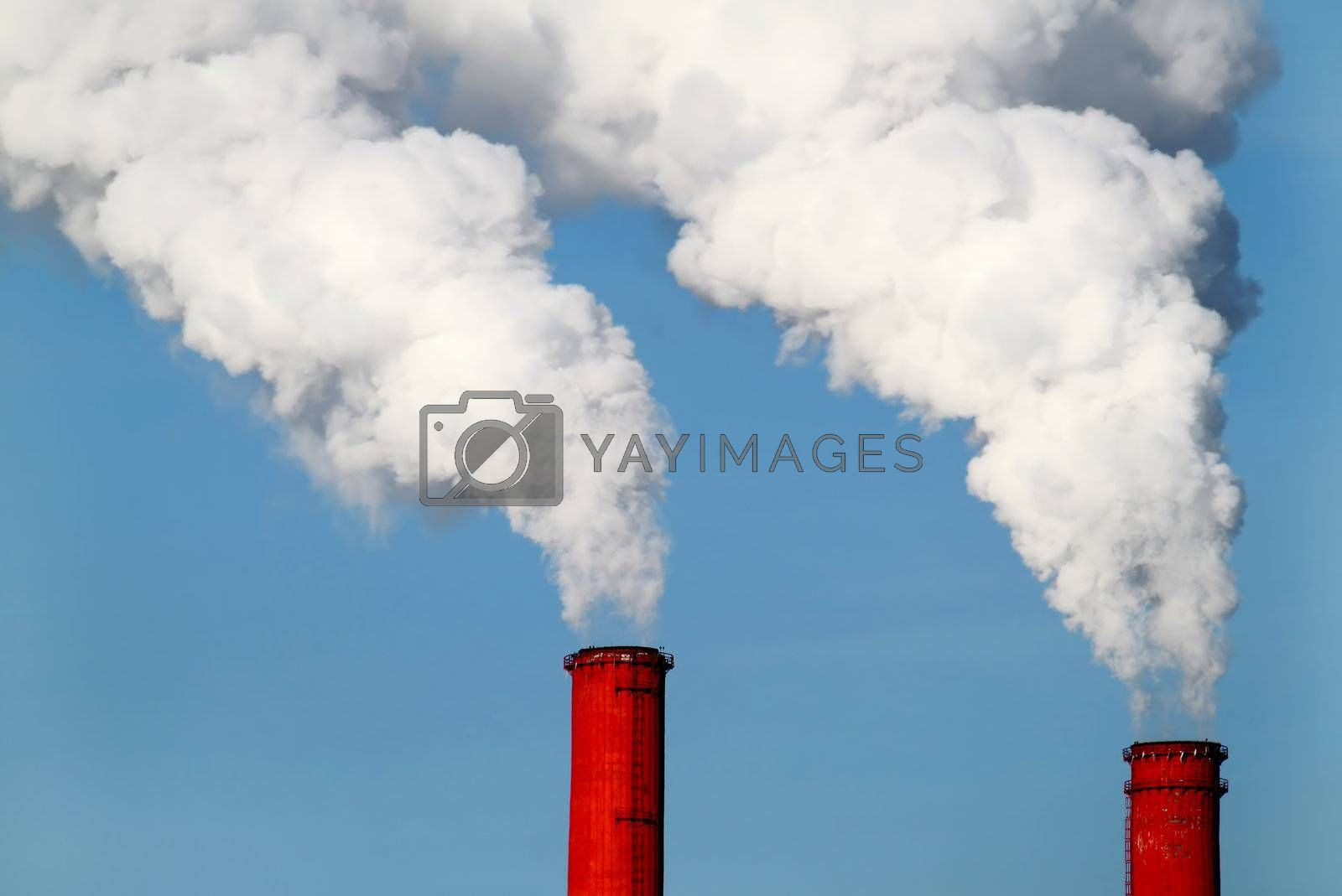 two red pipes and smoke on blue sky background
