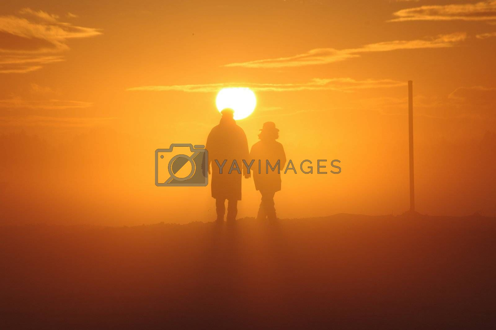 a couple have a walk through a misty landscape