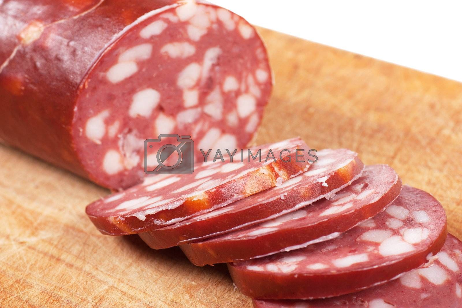 Slices of sausage on a wood board
