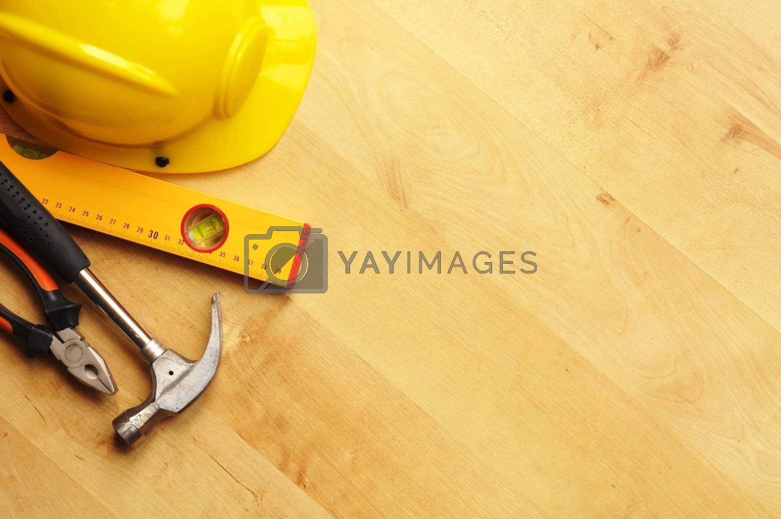 real estate concept with hard hat blueprints tools and copyspace