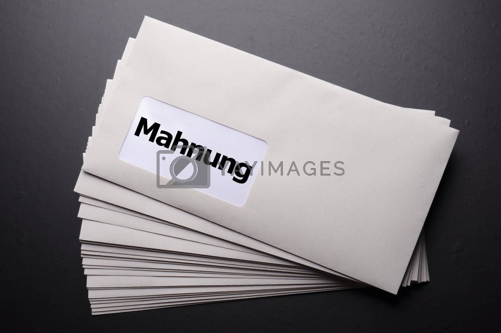 dunning or reminder concept with post letter and word