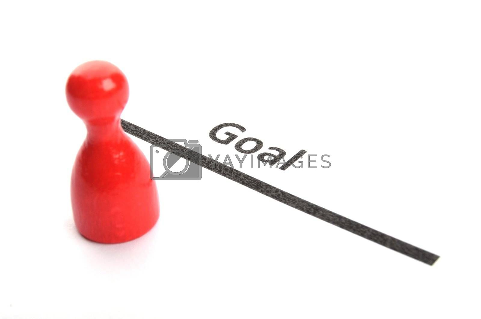 success or goal concept with pawns on white