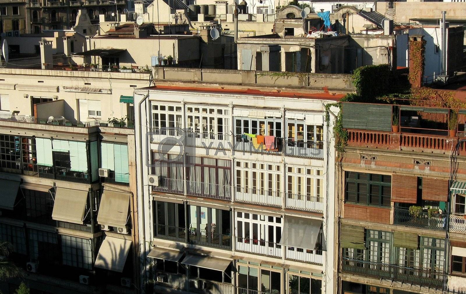 Towels hanging off railing in appartment building with no balconies