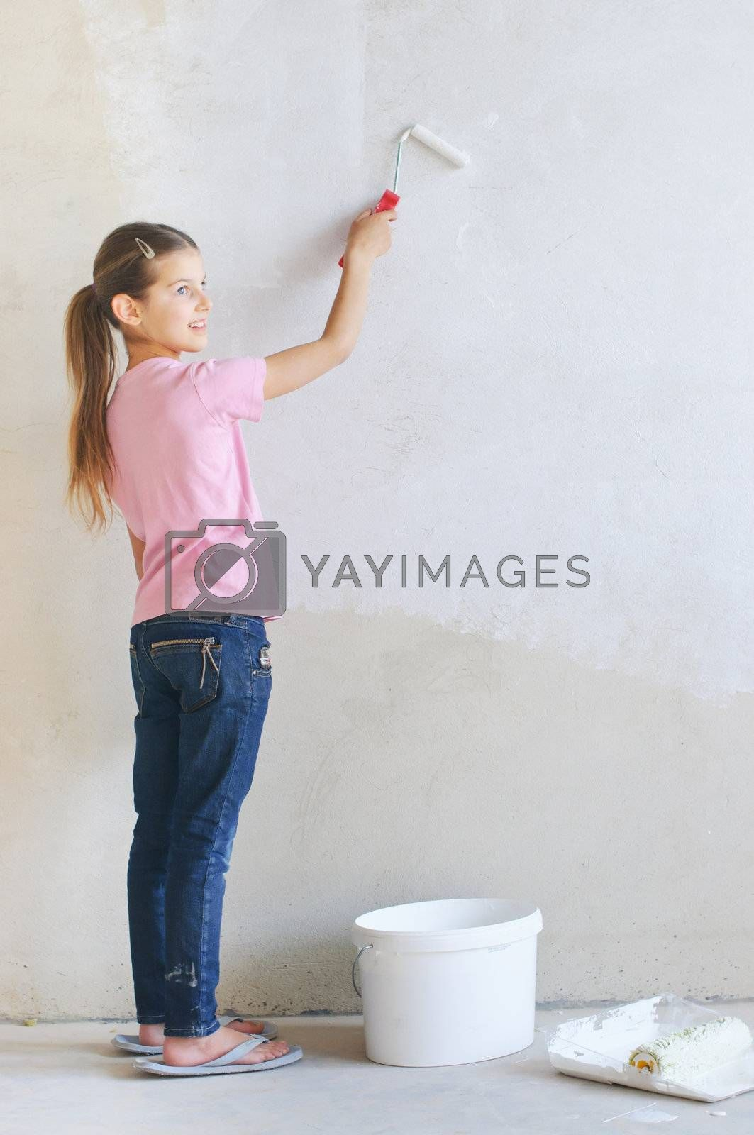 Home Improvement: Blond Woman Painting Wall Stock Image
