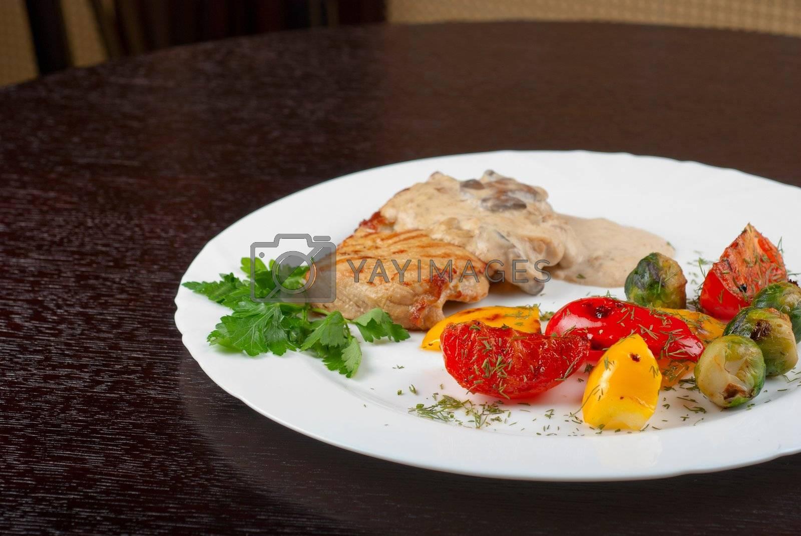 pork steak with mushroom sauce and grilled vegetables