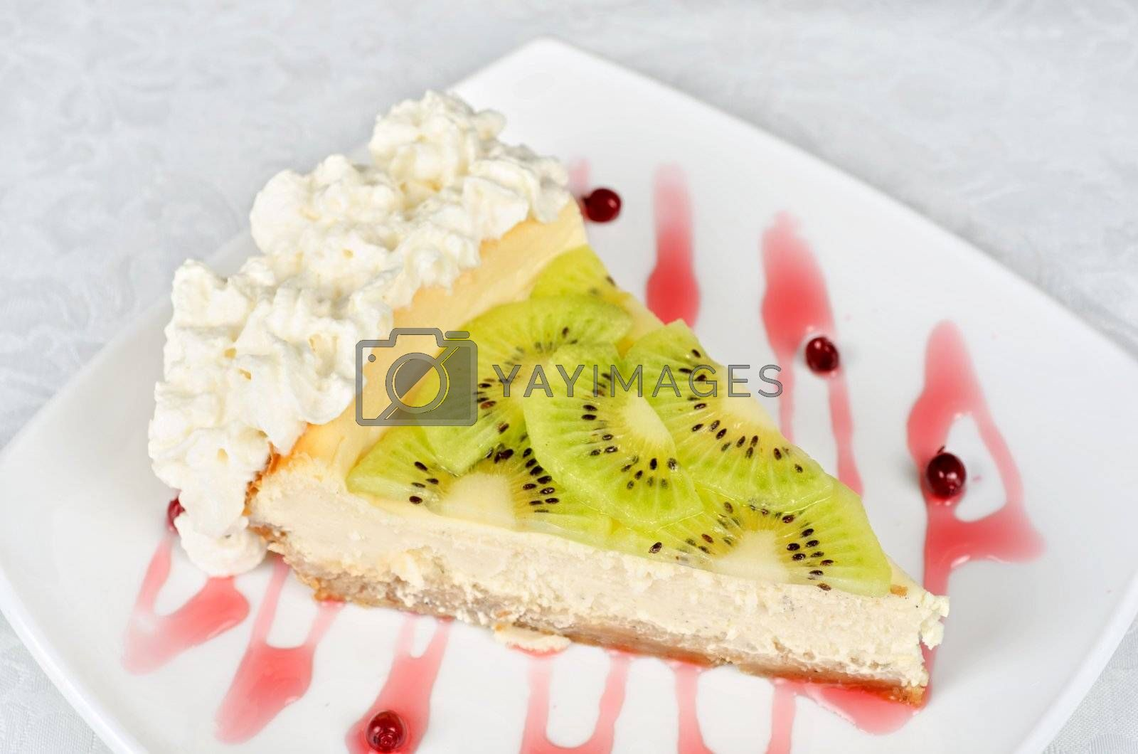 tasty kiwi fresh cake closeup at plate