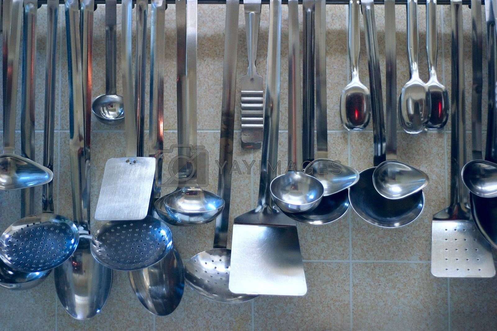 Many different tools for preparation of food at restaurant