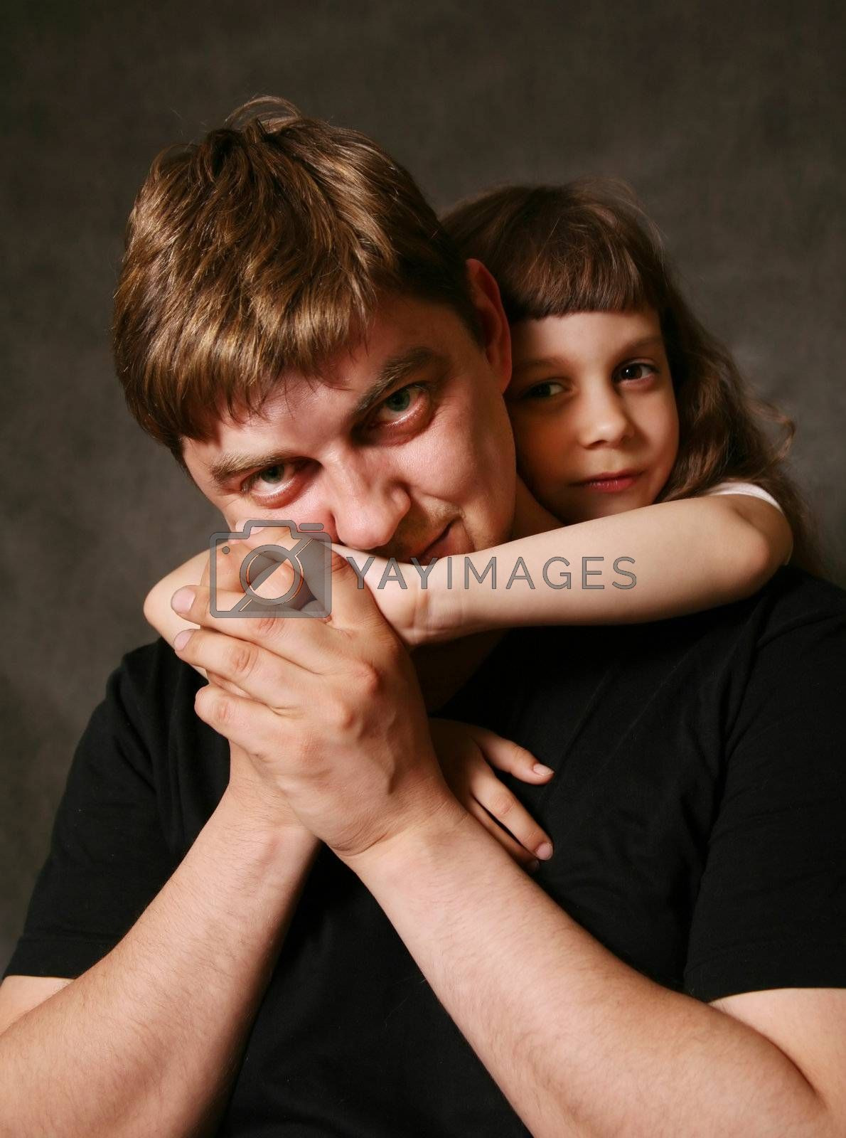 Double portrait. The daughter embraces the father