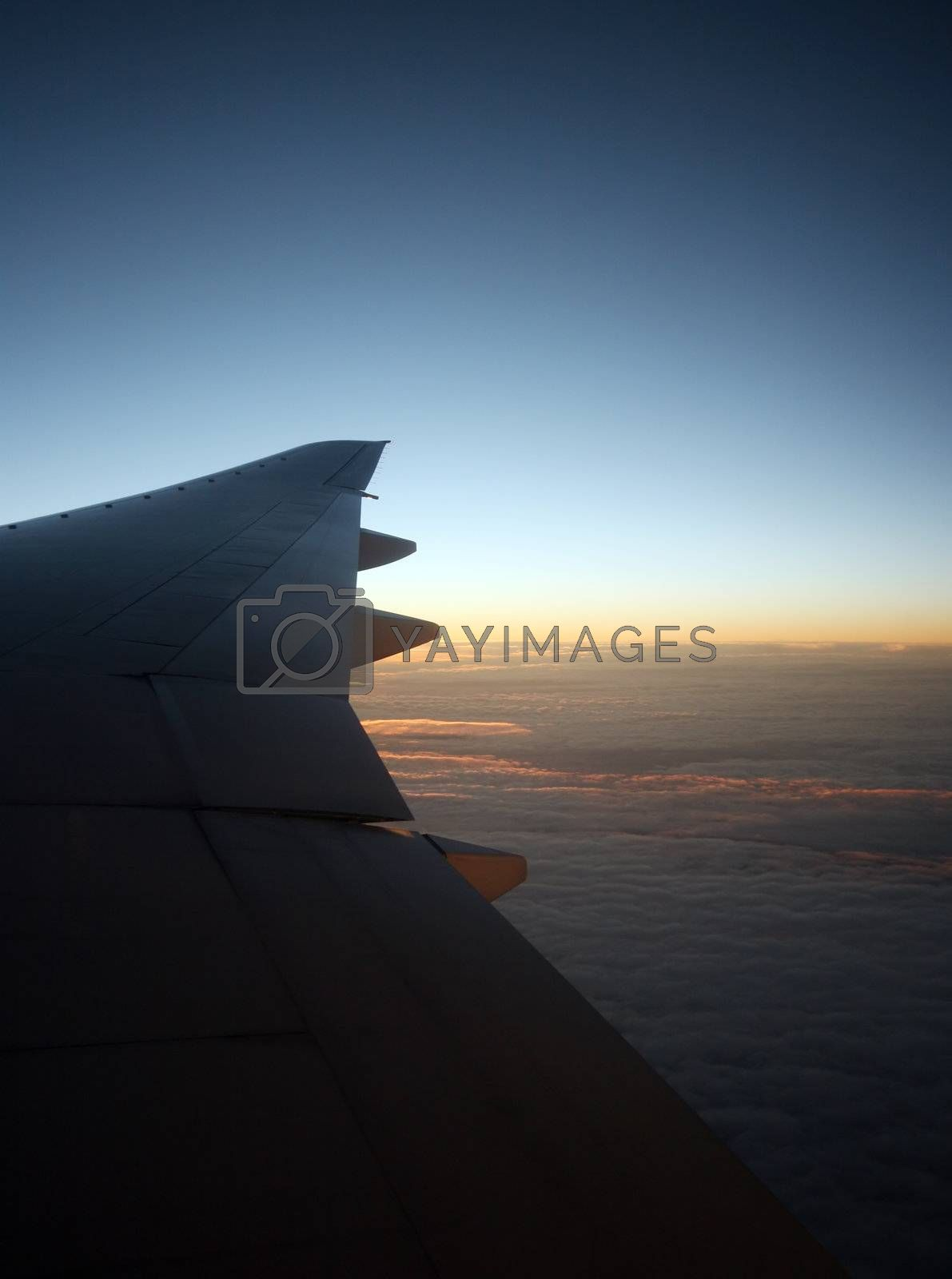 Wing of the plane on a background of clouds