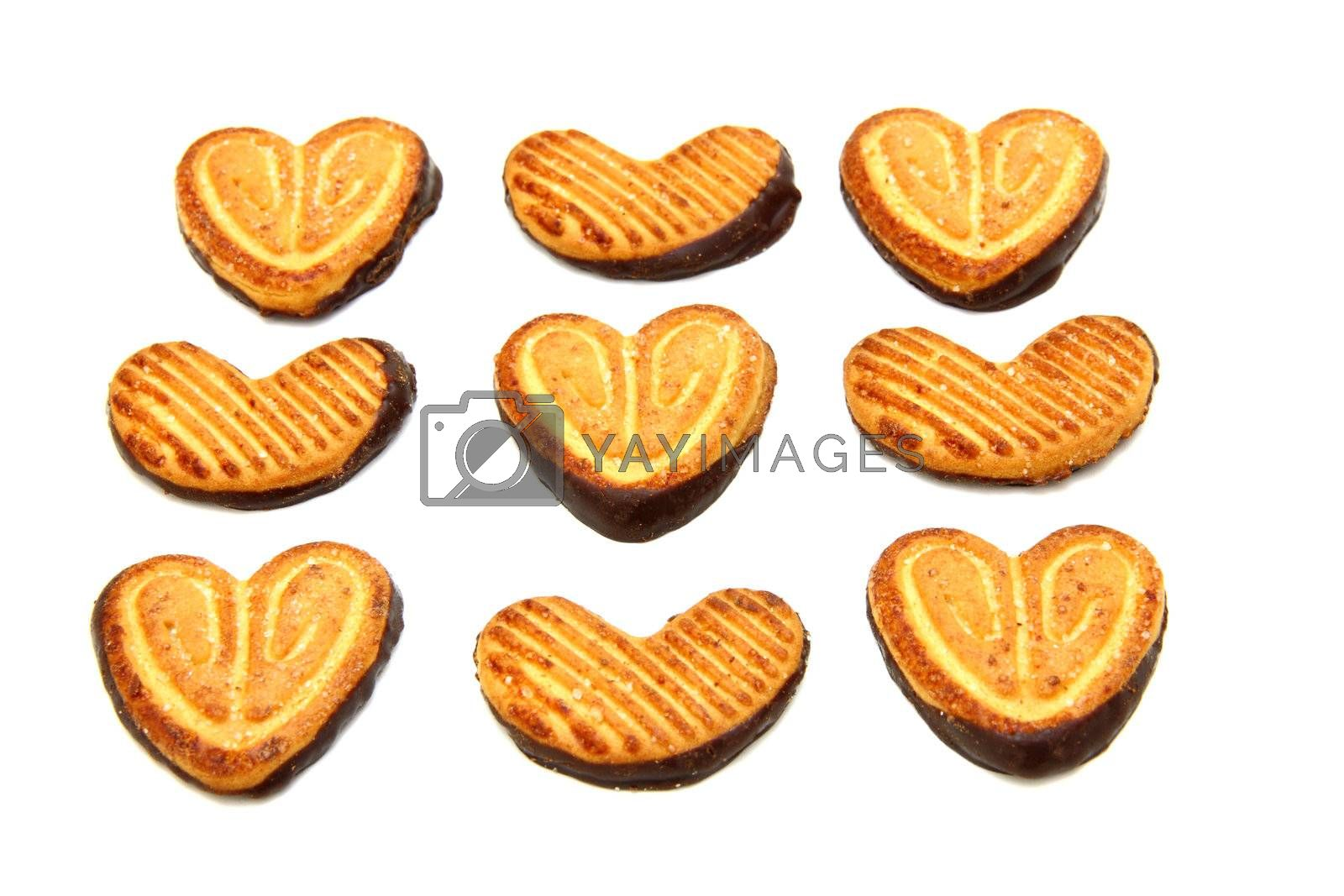 Cookies in the form of heart with chocolate on a white background