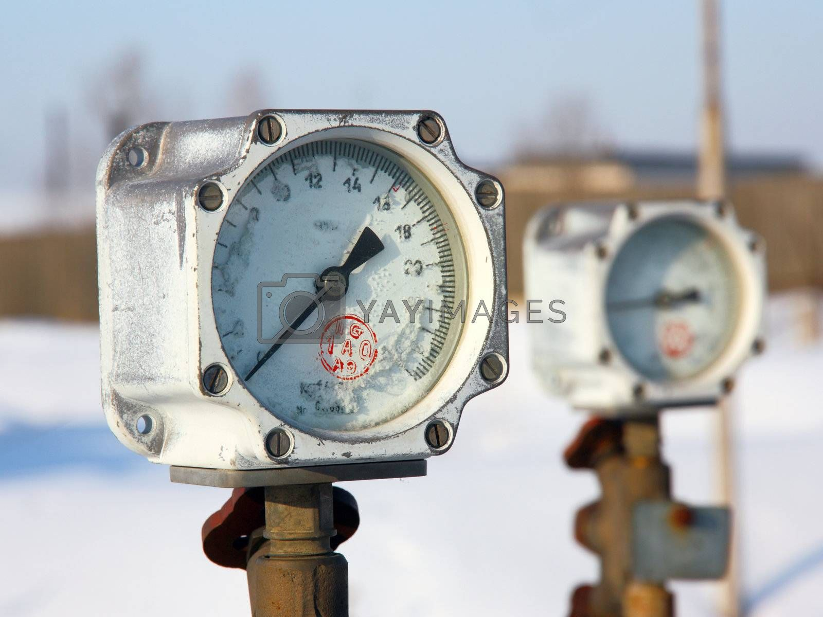 Old gas manometer in the winter in hoarfrost
