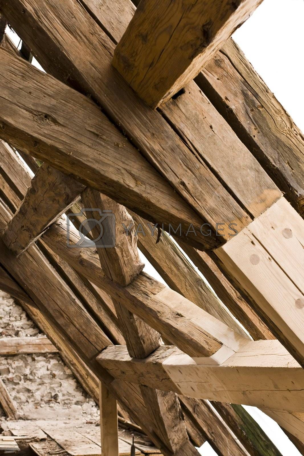 wooden framework on ancient roof with old and new wood