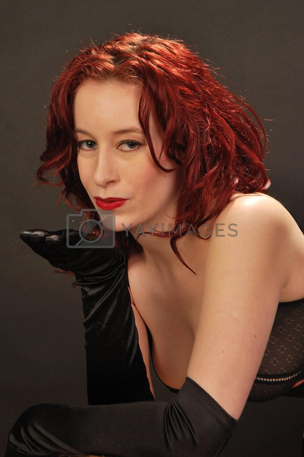 Sexy redhead blowing Kiss