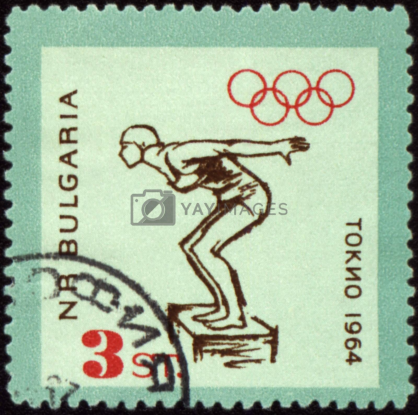 BULGARIA - CIRCA 1964: A post stamp printed in Bulgaria shows jumping swimmer, devoted to Olympic games in Tokio, series, circa 1964
