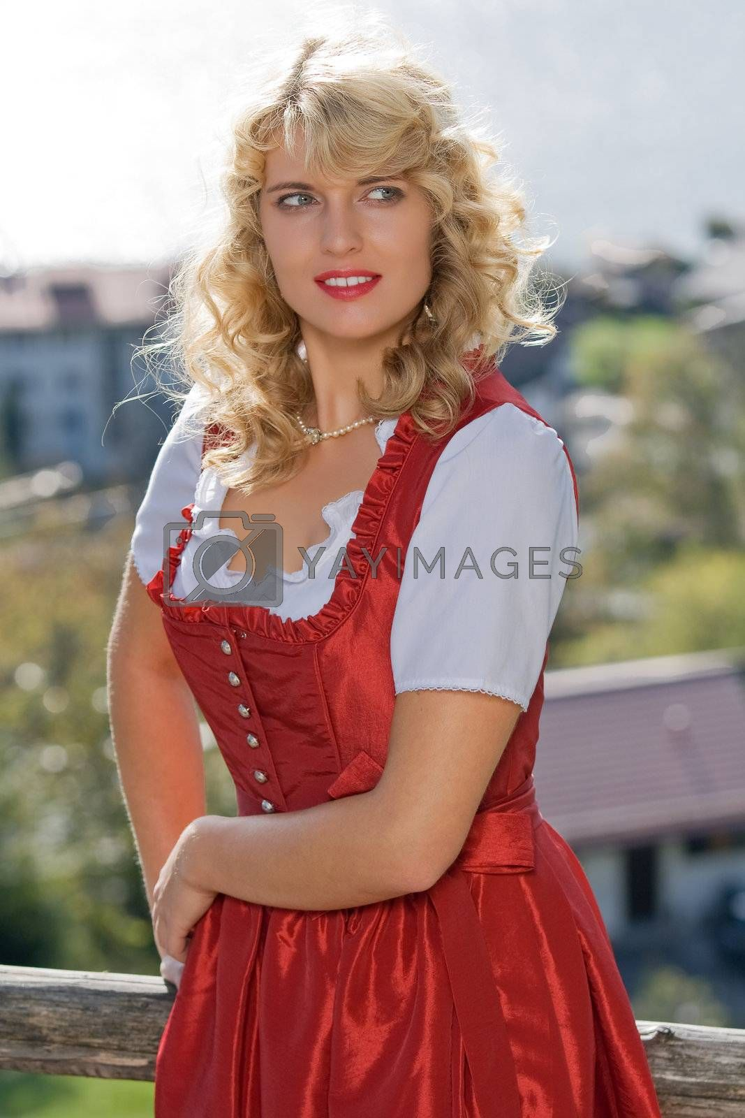 young blond woman in red Bavarian dress