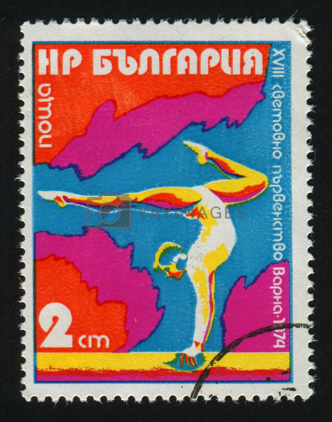 BULGARIA - CIRCA 1974: Gymnast on Parallel Bars, circa 1974.