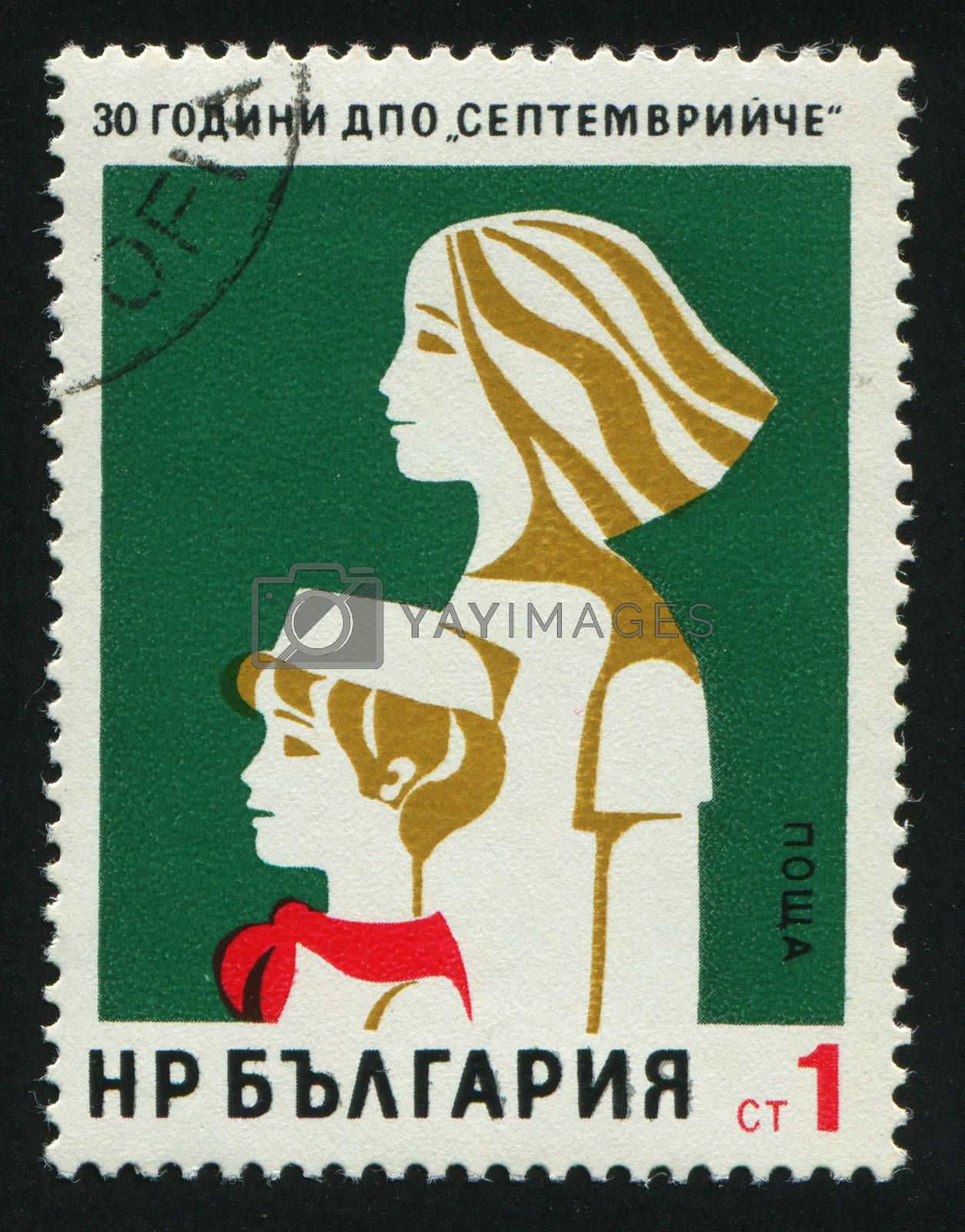 BULGARIA - CIRCA 1975: Pioneer and Komsomol Girl, circa 1975.