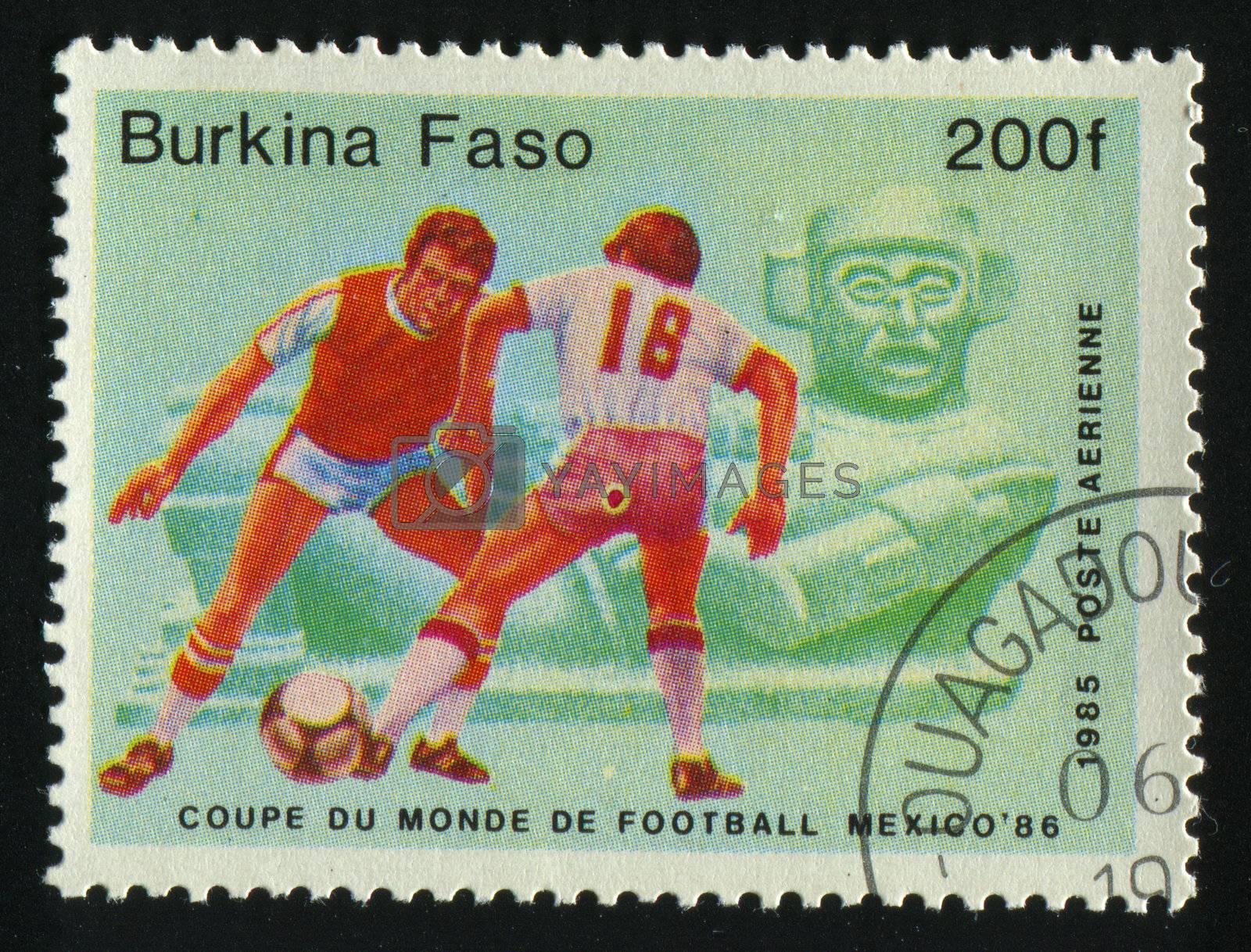 BURKINA FASO - CIRCA 1986: stamp printed by Burkina Faso, shows soccer players and ball. Championships Mexico, circa 1986.