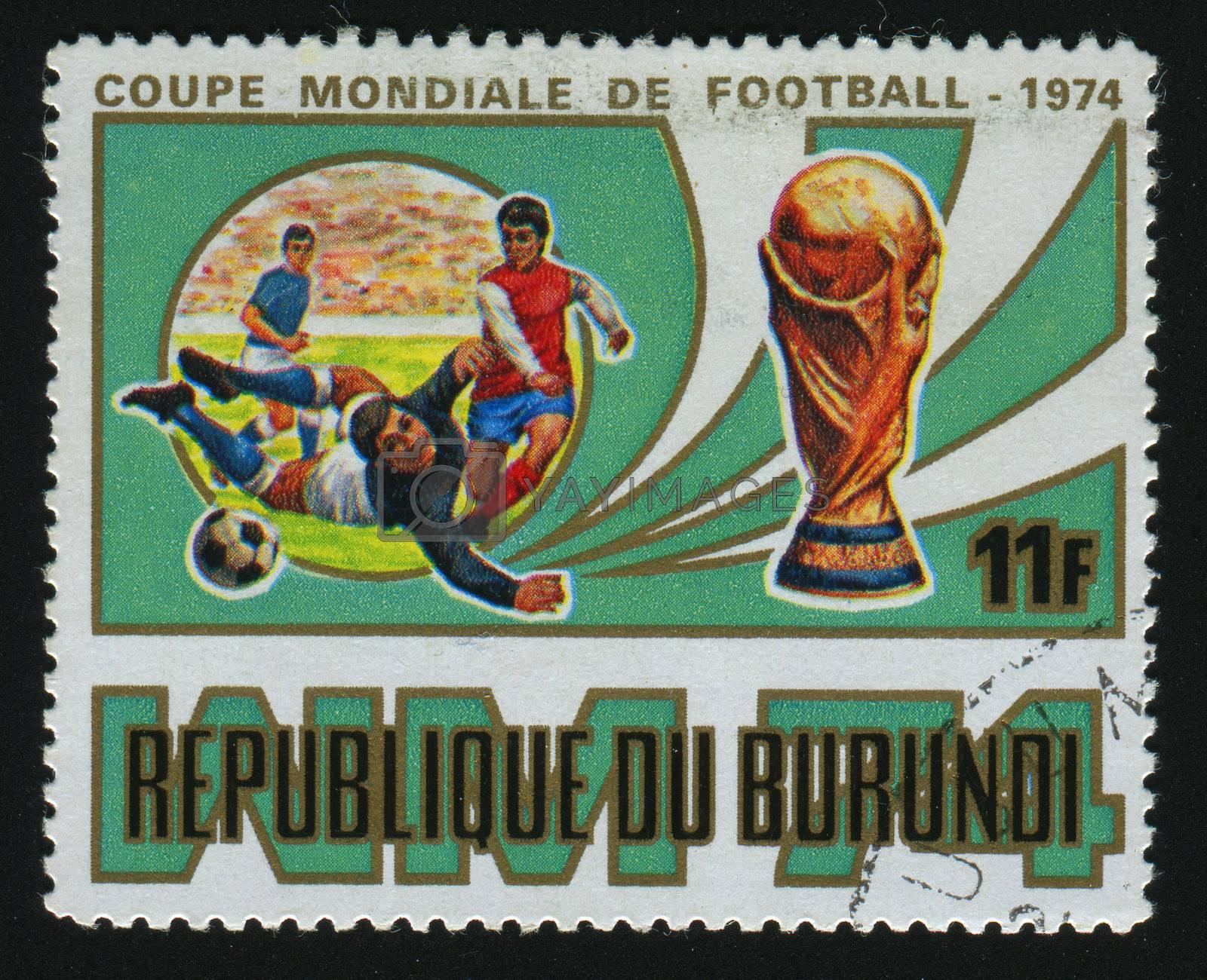 BURUNDI - CIRCA 1974: stamp printed by Burundi, shows soccer players and ball, circa 1974.