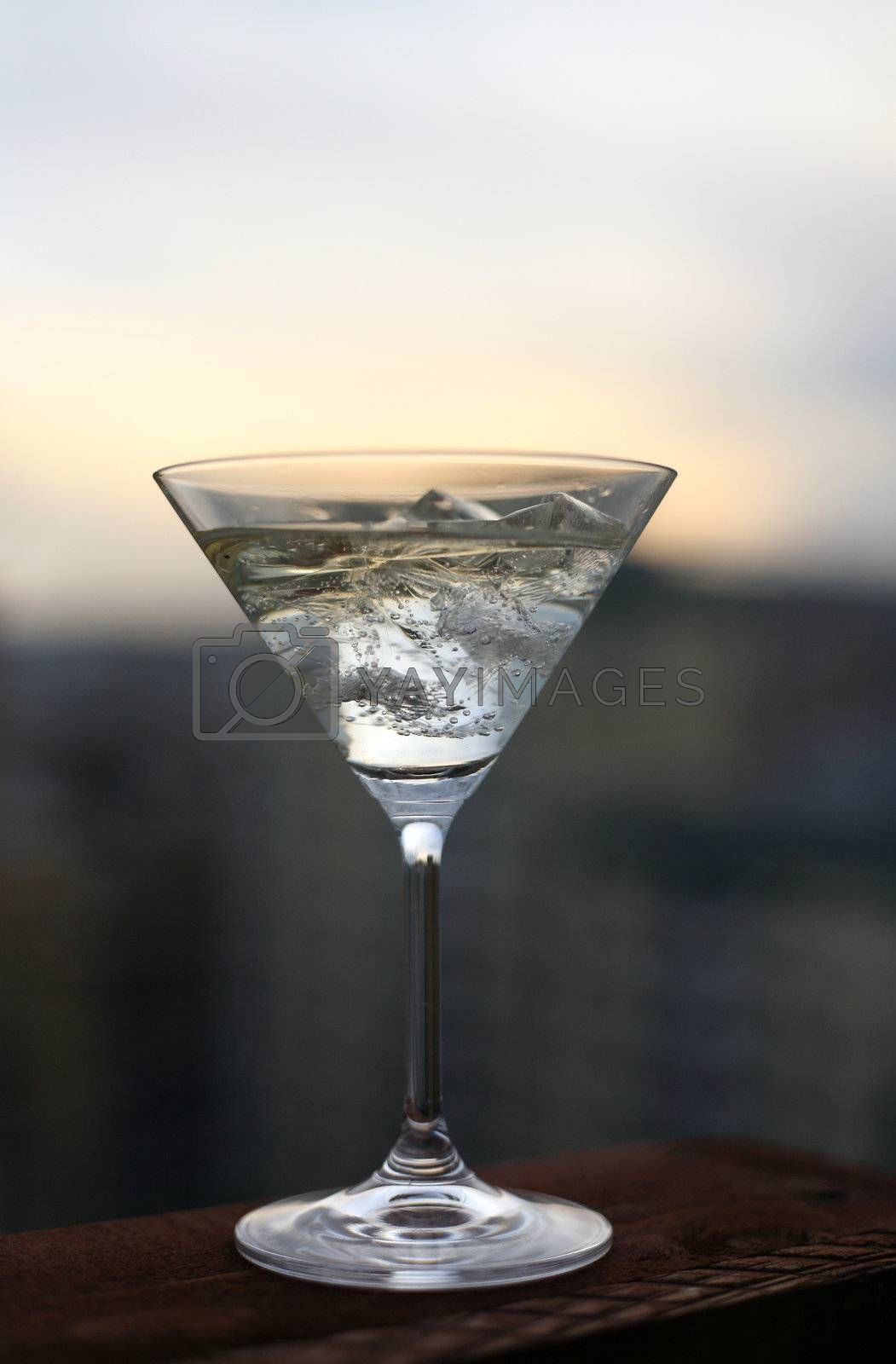 The image of a glass filled with a spirits drink and ice
