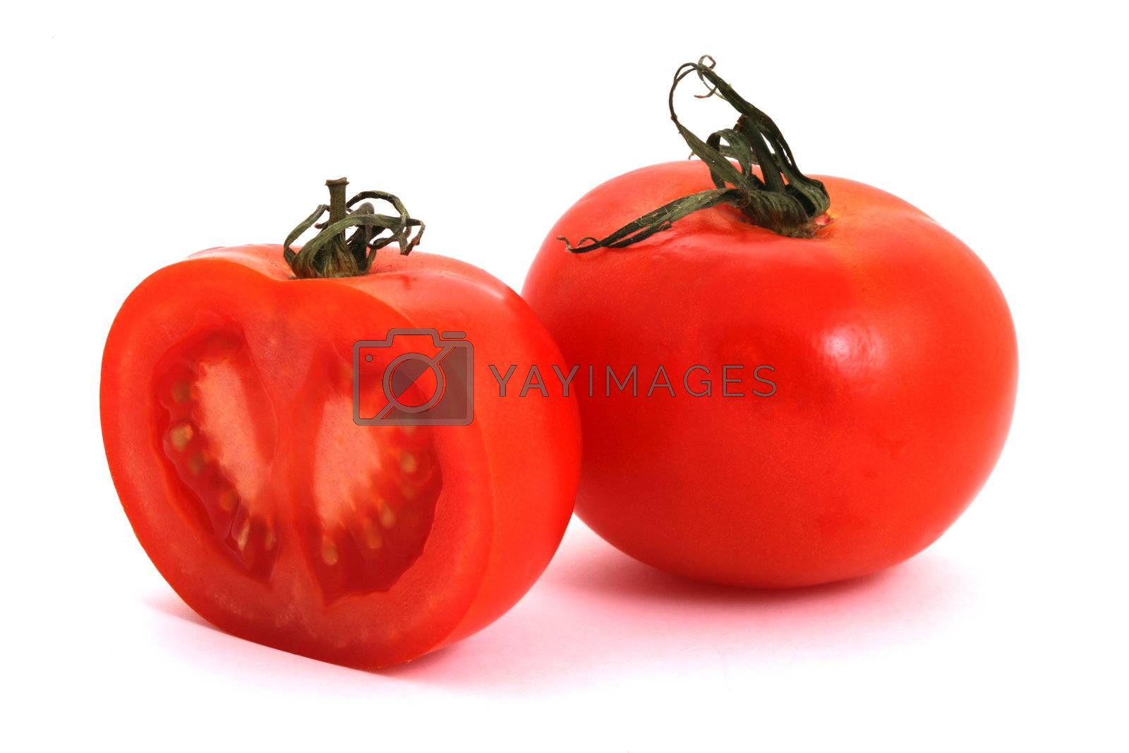 Tomato and half of tomato on a white background