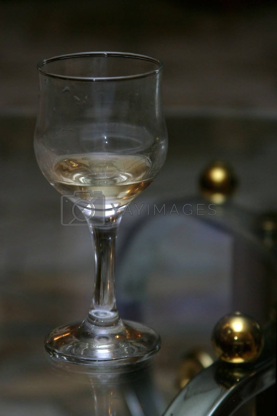 Wine glass with a wine on a transparent table